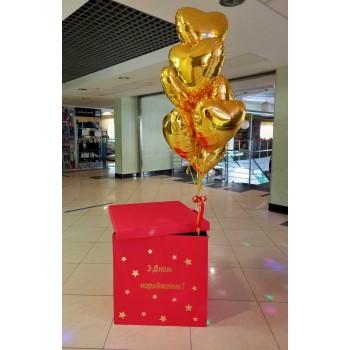 Коробка з кульками червона